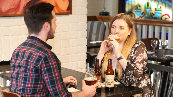 Couple drinking Samuels Wheat Beer